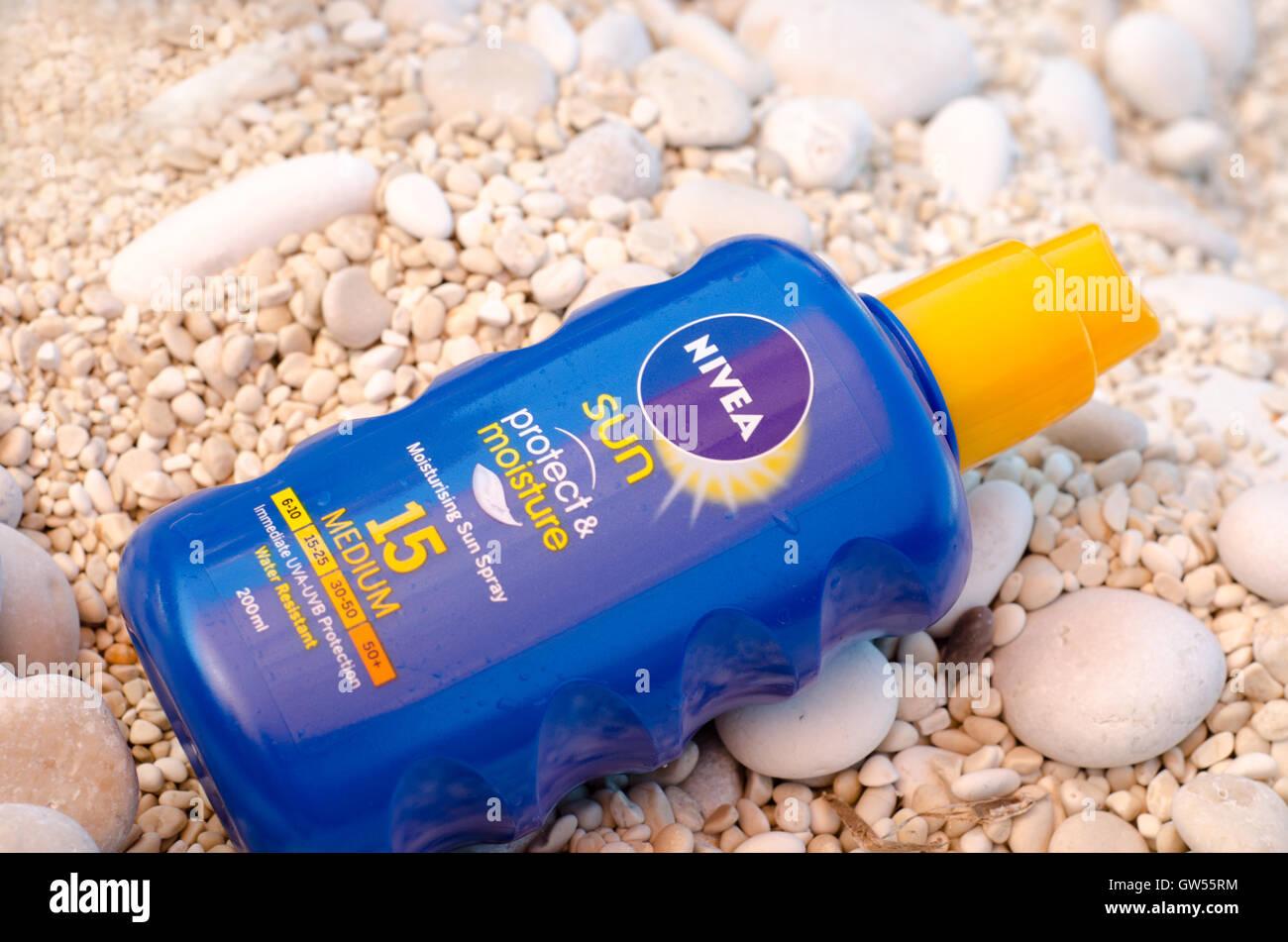 Nivea Suncream on pebble beach - Stock Image