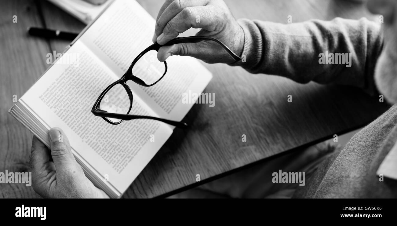 Elderly Man Reading Book Relax Concept - Stock Image