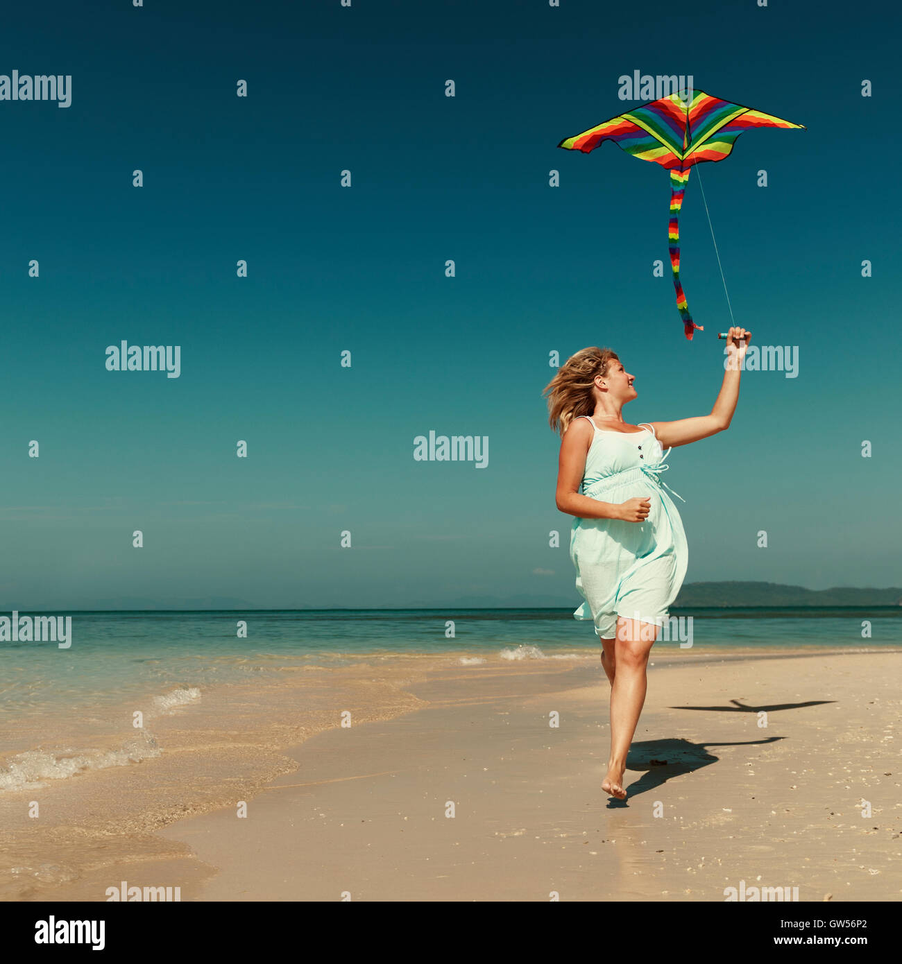 Beach Kite Flying Getaway Holiday Concept - Stock Image