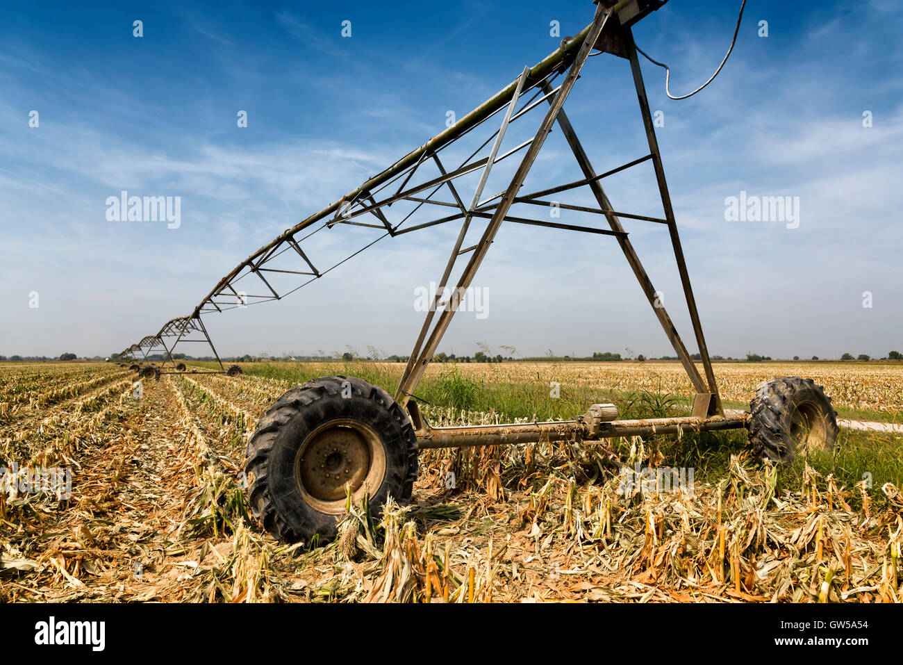 irrigation system on a harvested field - Stock Image
