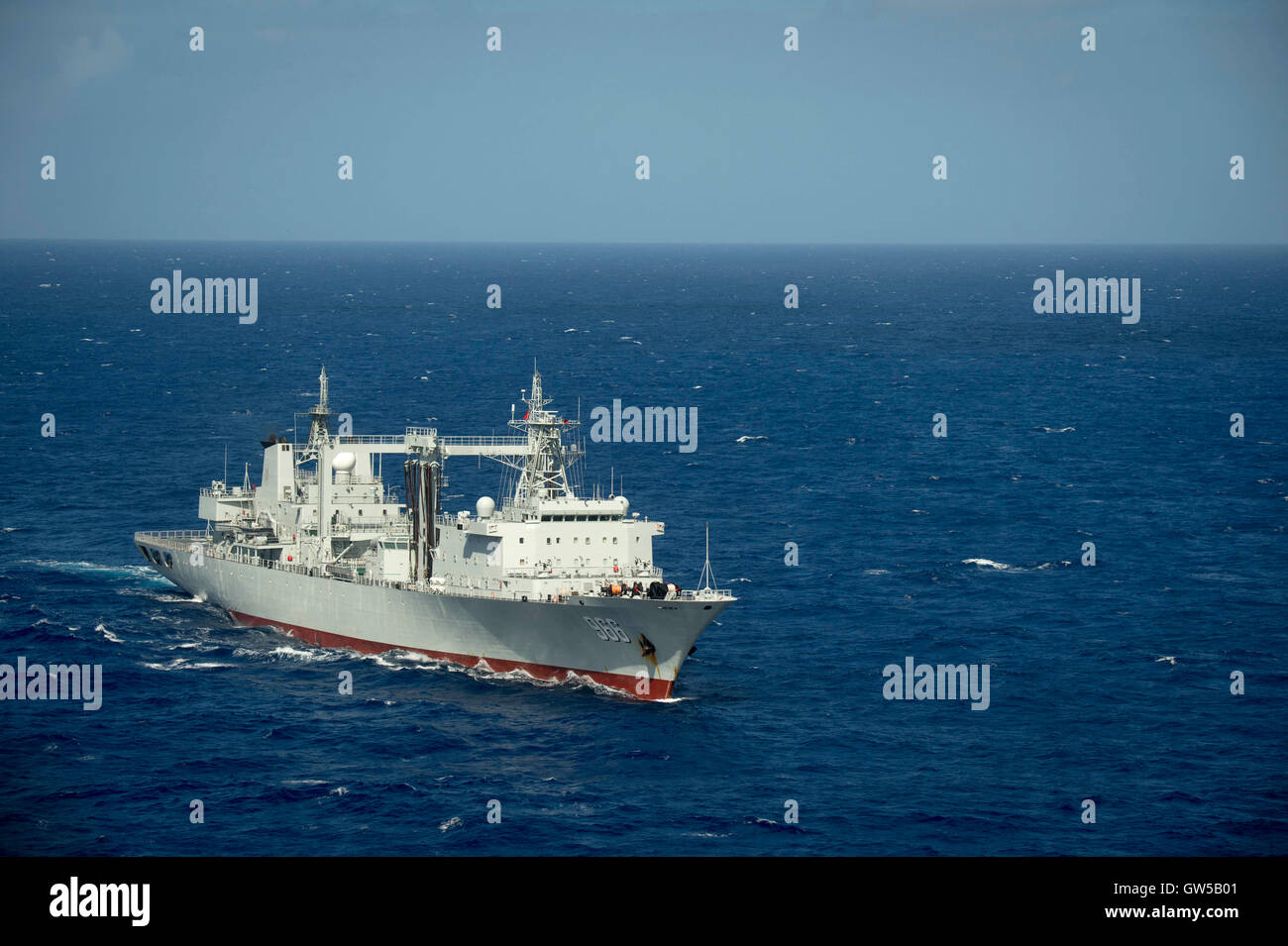 Chinese Navy replenishment ship Gaoyouhu steams in close formation during the Rim of the Pacific exercise June 22, - Stock Image