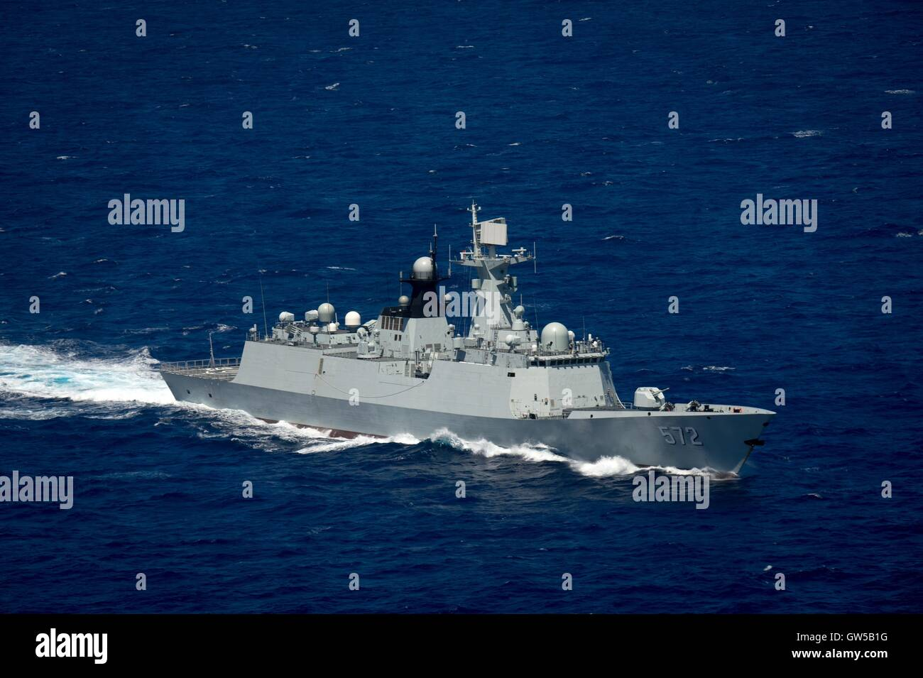 Chinese Navy multi-role frigate Hengshui steams in close formation during the Rim of the Pacific exercise June 22, - Stock Image