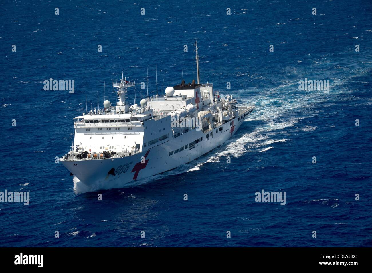 Chinese Navy hospital ship Peace Ark steams in close formation during the Rim of the Pacific exercise June 22, 2016 - Stock Image