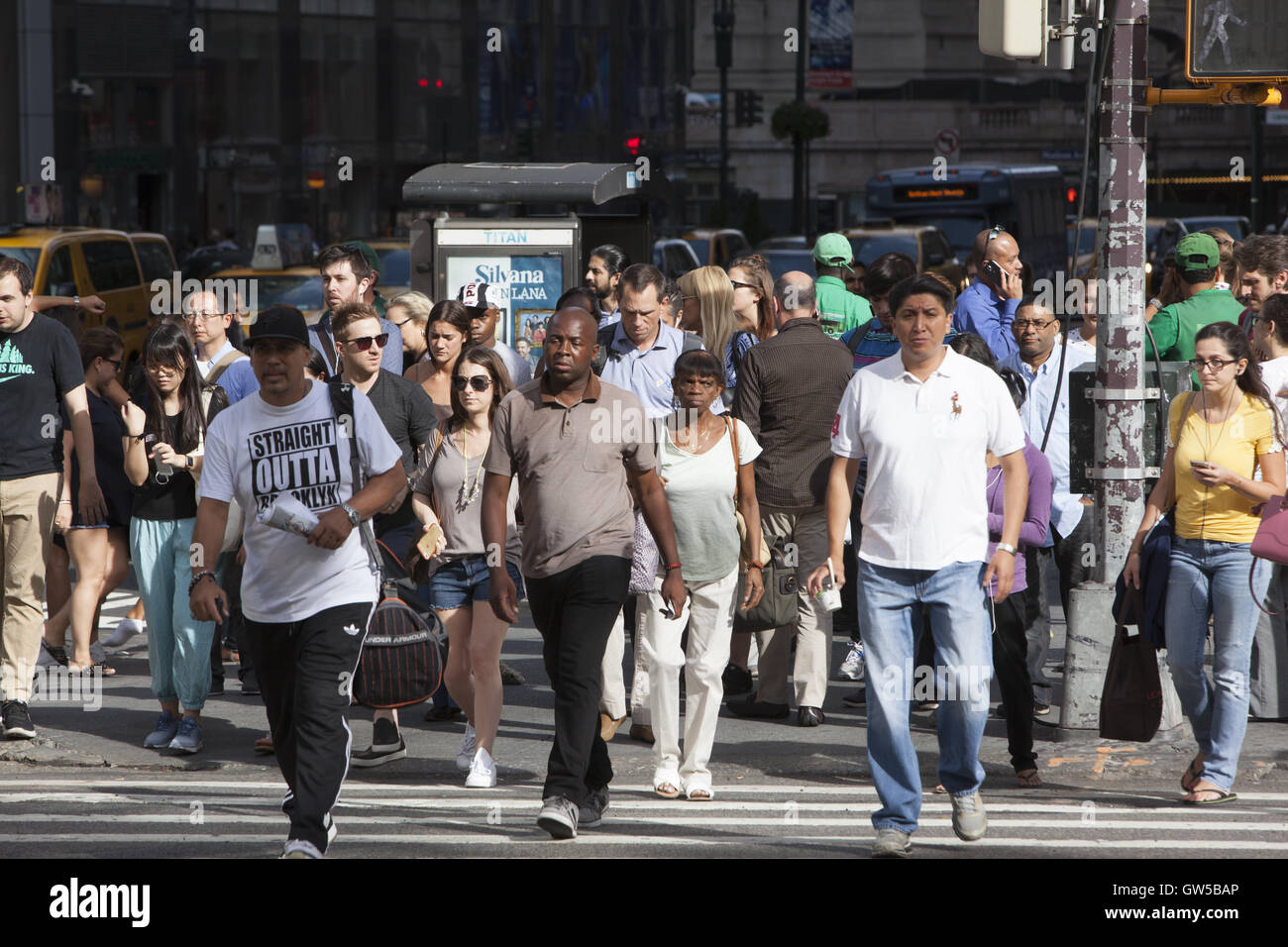 The crosswalks are always jammed at 5th Avenue and 42nd Street in midtown Manhattan. - Stock Image