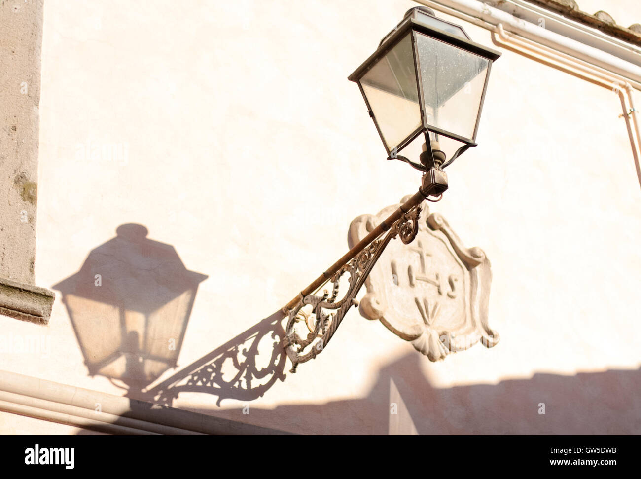 antique wall lantern (streetlamp) with shadow. - Stock Image