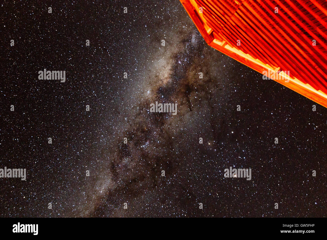 "The house points to The Milky Way - The Milky Way is the galaxy that contains our Solar System. Its name ""milky"" Stock Photo"