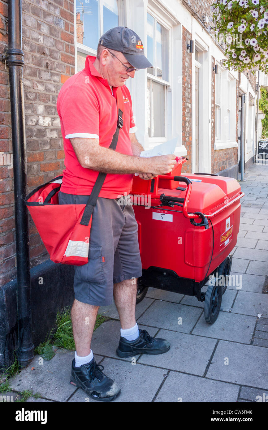 Royal Mail Postman On Delivery Round England Gb Uk Letters