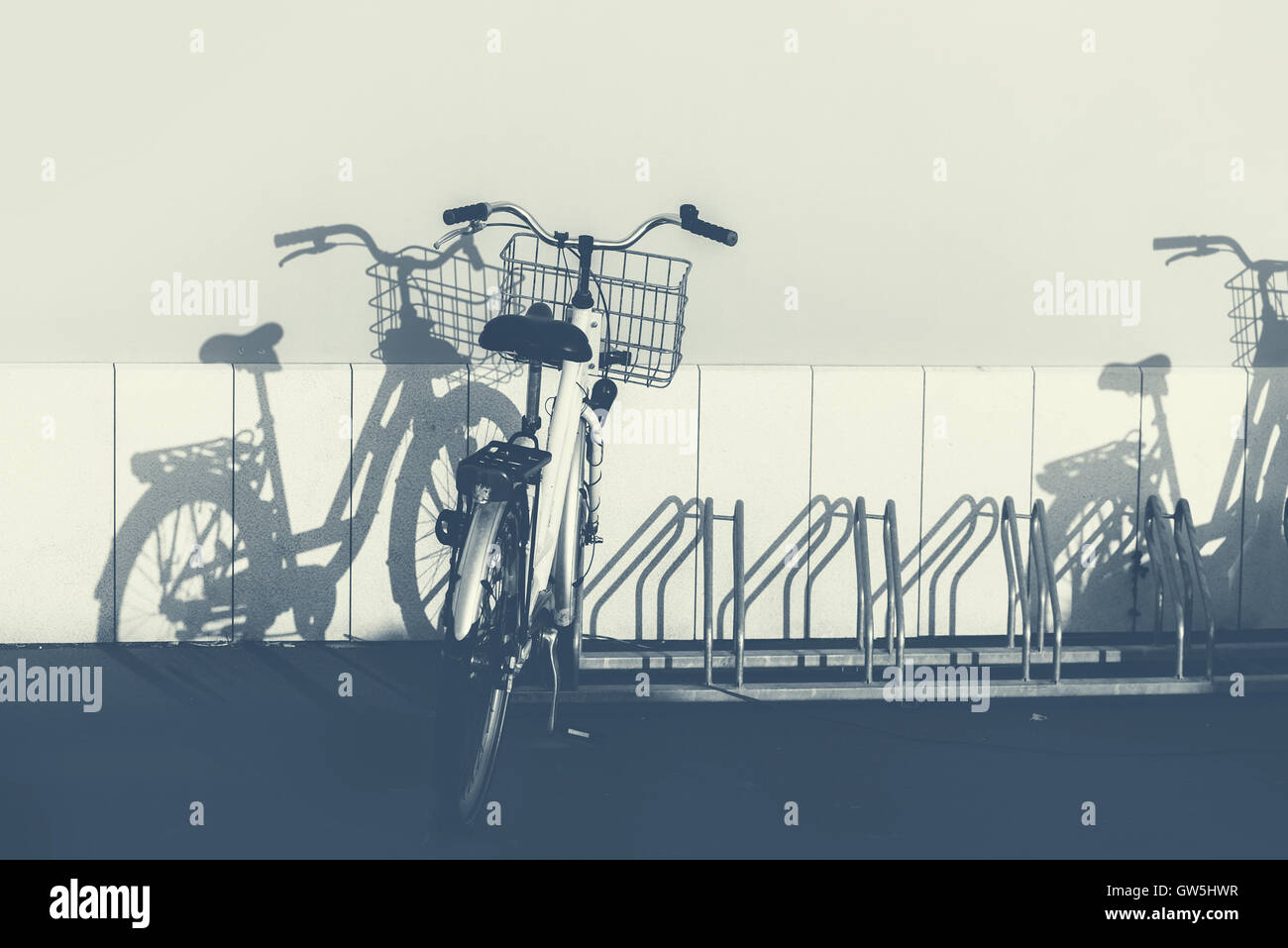 Bicycles and shadows, monochromatic image - Stock Image