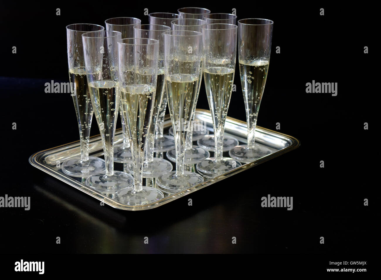 Champagne flutes glasses isolated on black background - Stock Image