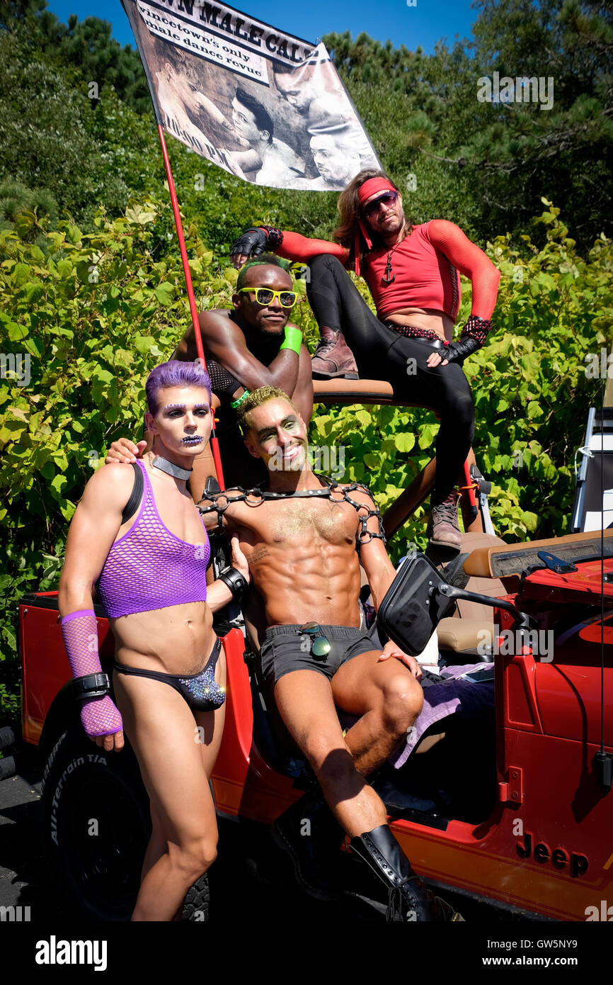 Four gay entertainers prepare to participate in a Carnival parade in Provincetown, MA, USA - Stock Image