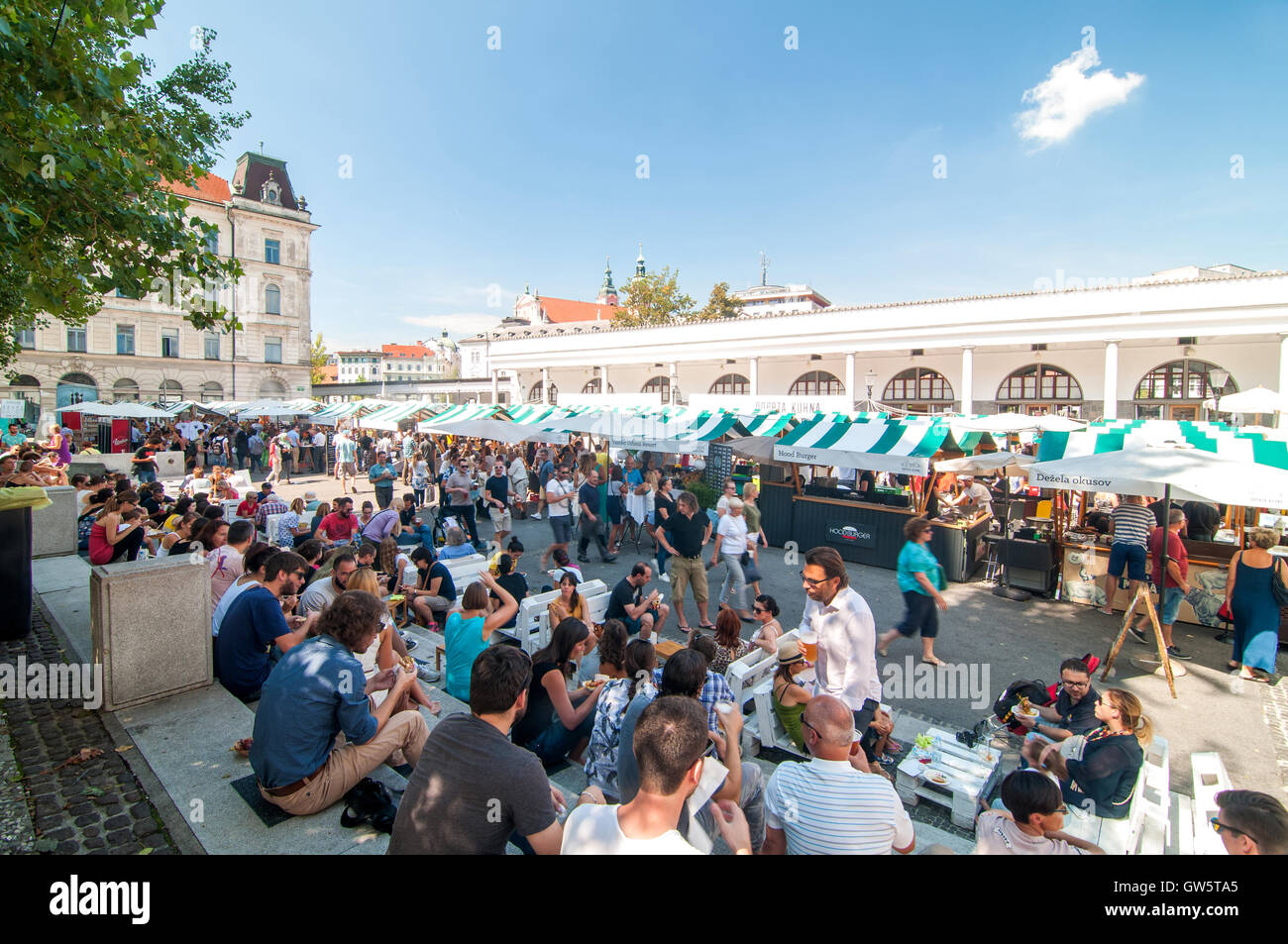 Ljubljana, Slovenia - September 2, 2016 People walking and eating at an Open kitchen, Ljubljana, Slovenia - Stock Image