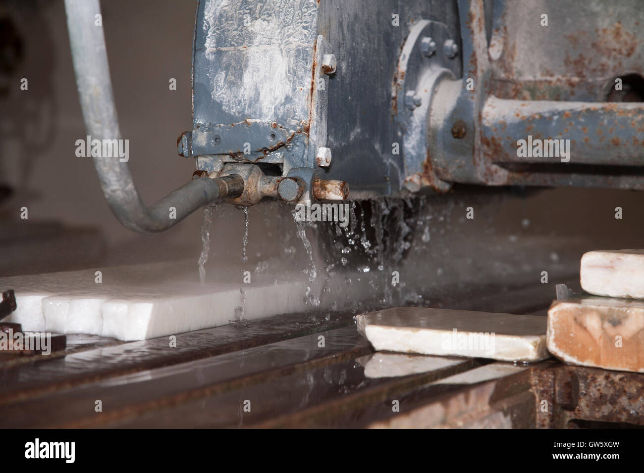 Water cooled saw cutting marble stone. Portugal - Stock Image