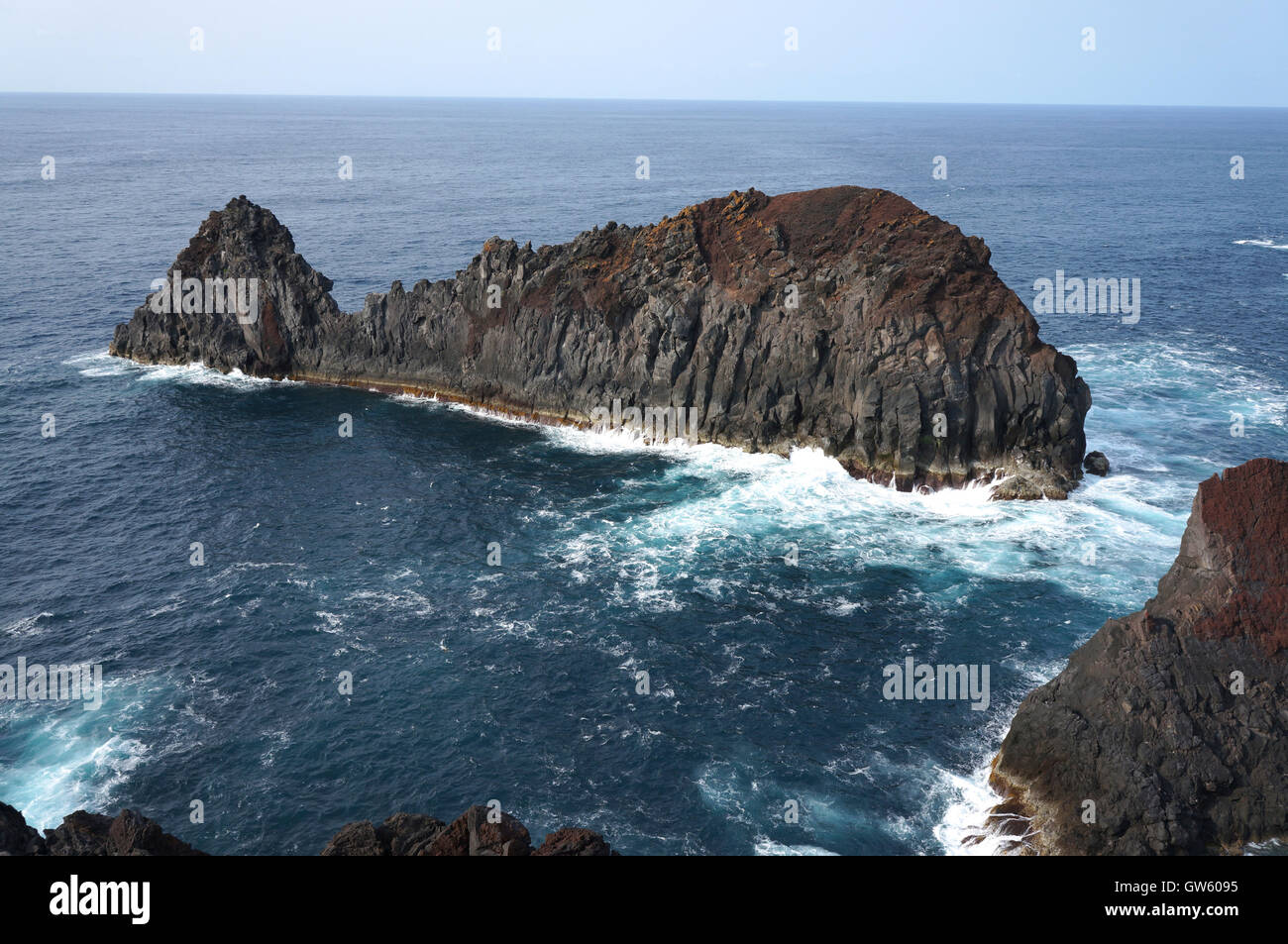 Whale rock or Baleia Islet at Ponta da Barca bay. Basaltic reddish rock with a whale configuration. Azores, Portugal - Stock Image