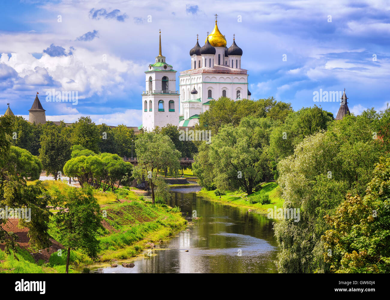 The golden dome of Trinity Church and towers of Pskov Kremlin (Krom) reflecting in the river, Pskov, Russia. - Stock Image