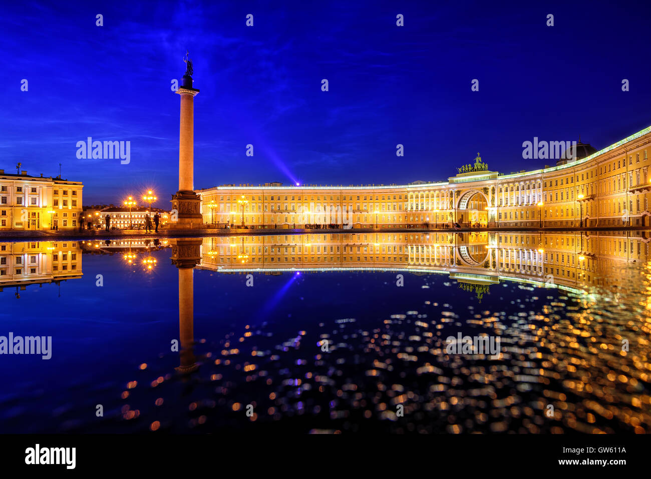 General Staff building and Alexander Column reflecting in rain water on Palace Square in St Petersburg, Russia, - Stock Image