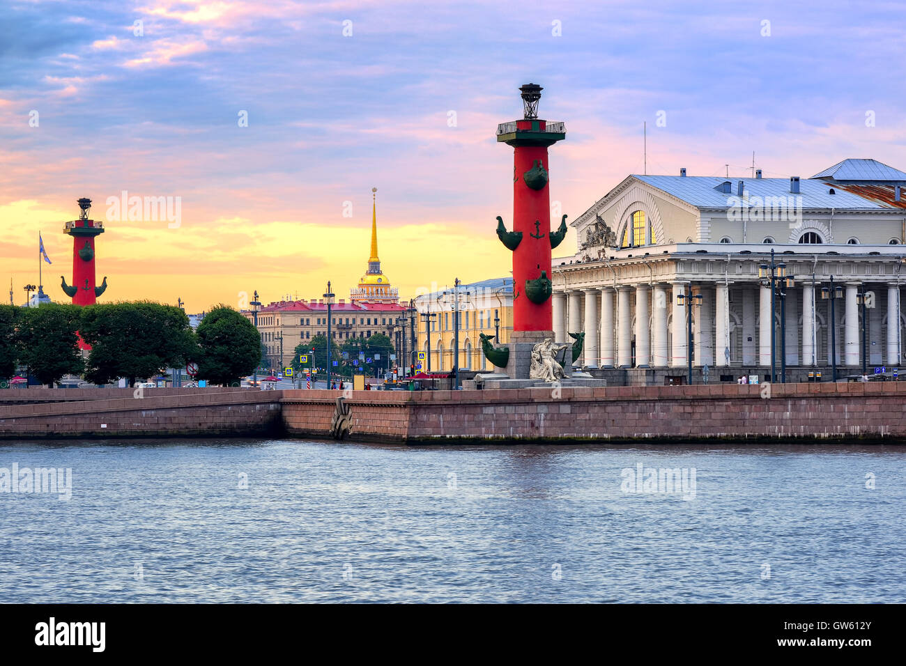 Old Saint Petersburg Stock Exchange, Rostral Columns and golden spire of Admiralty Building at Neva river on sunset, - Stock Image