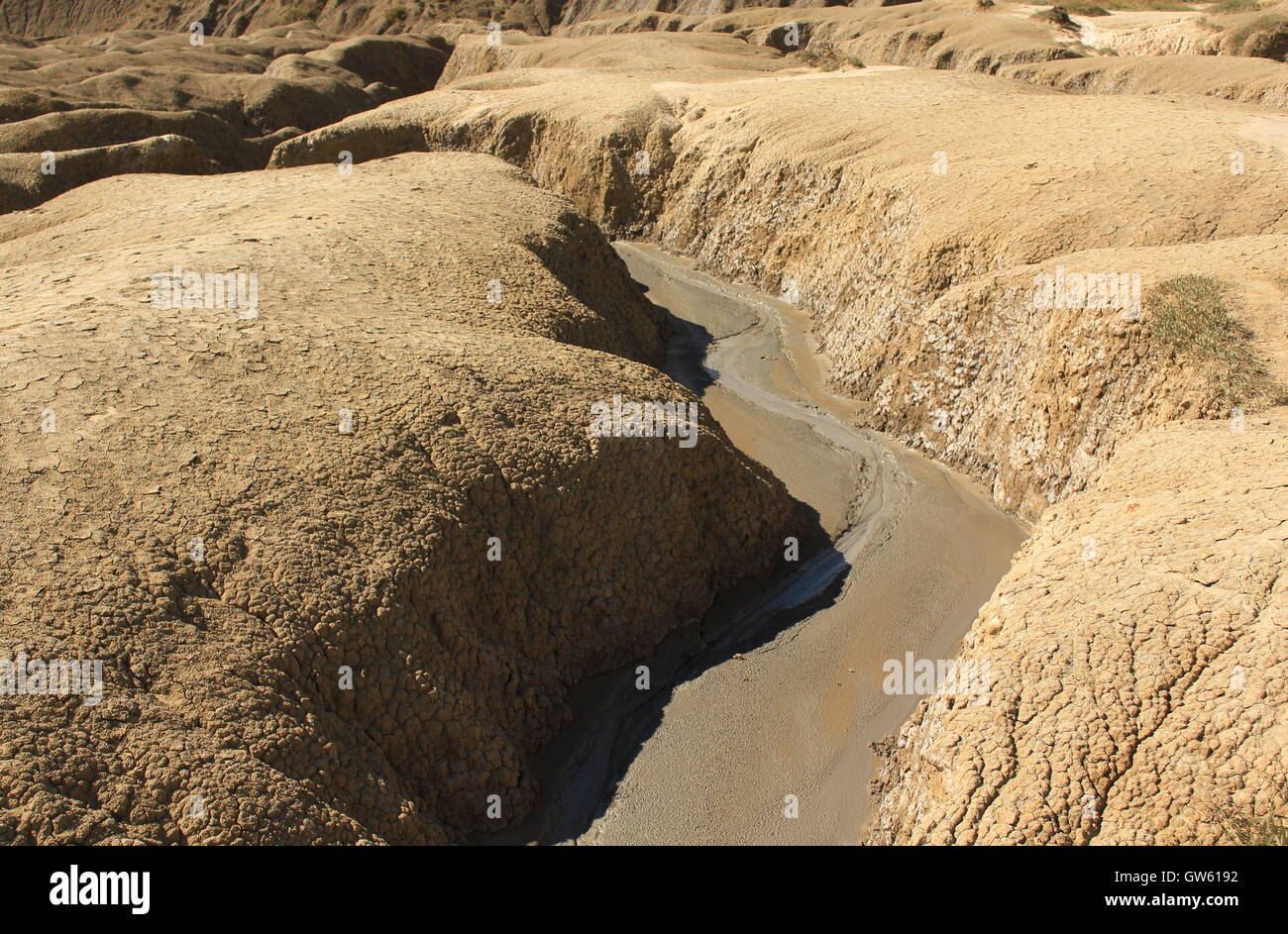 river of mud made by a mud volcano - Stock Image