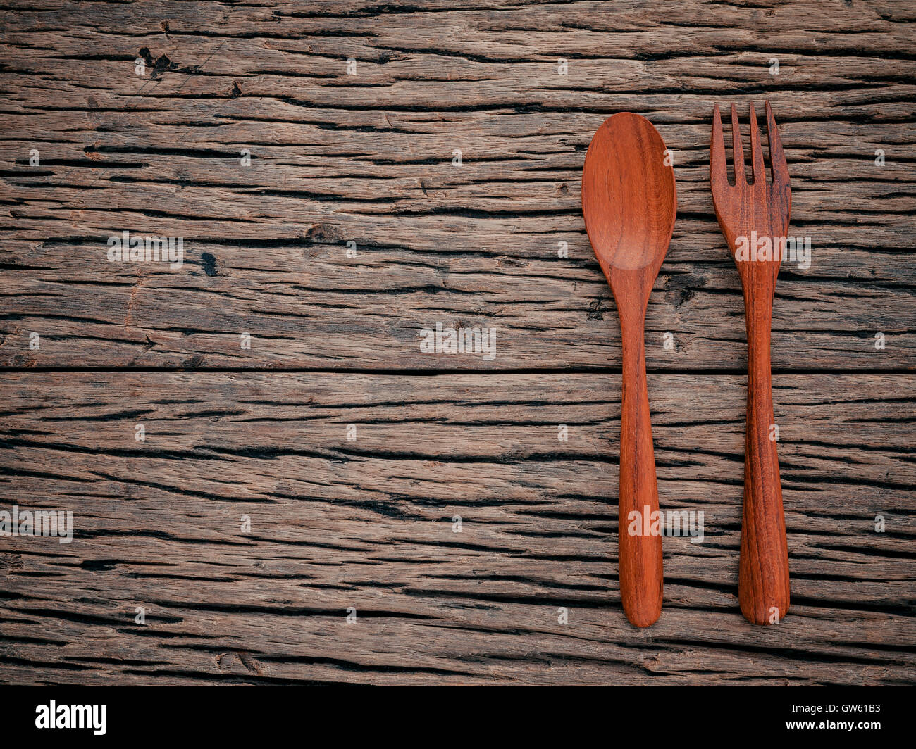 fork and spoon on grunge wood food background concept