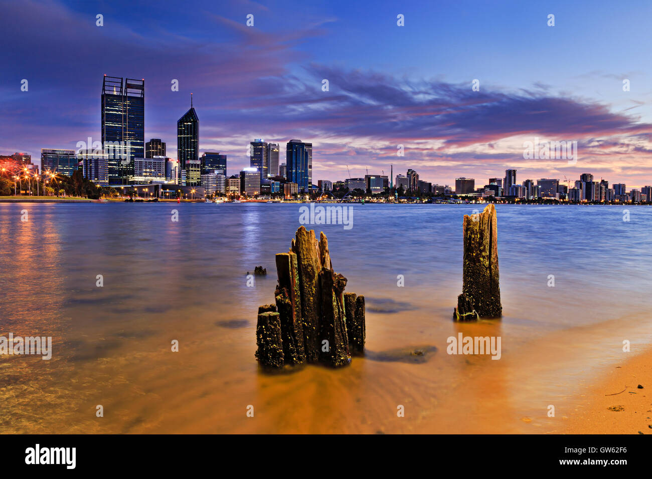 Western Australia capital city Perth at sunrise across Swan river clear waters from sandy beach to CBD. - Stock Image
