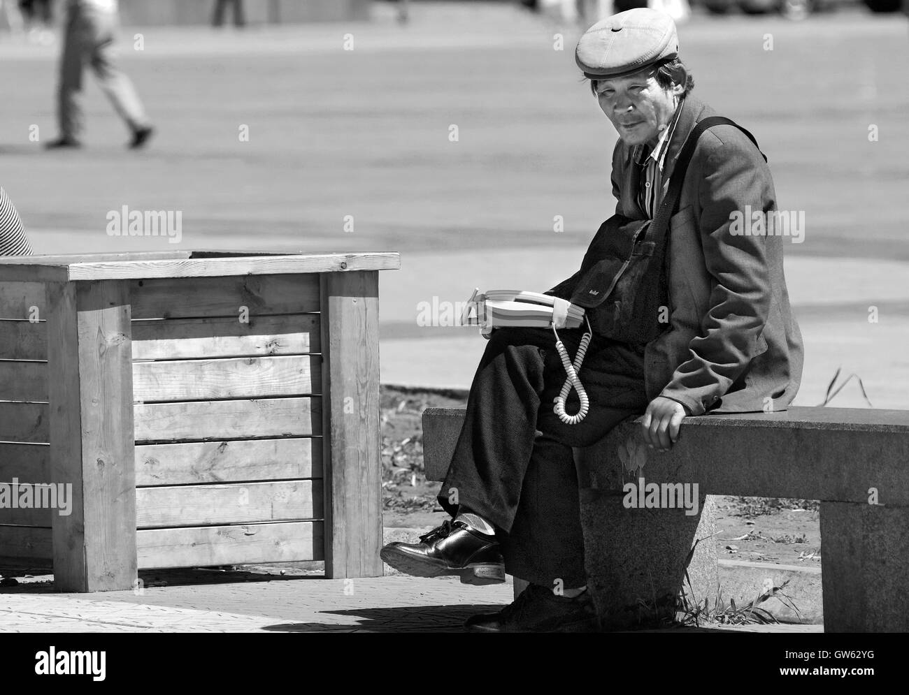 A solitary man waiting for customers to rent his phone to call their relatives, Ulan Bator, Mongolia - Stock Image