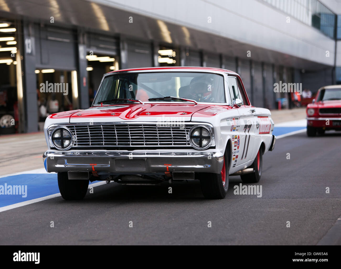 Steven Wood exiting the International Pit lane in a 1964 Ford Falcon for qualifying in the Pre'66 Big Engine - Stock Image