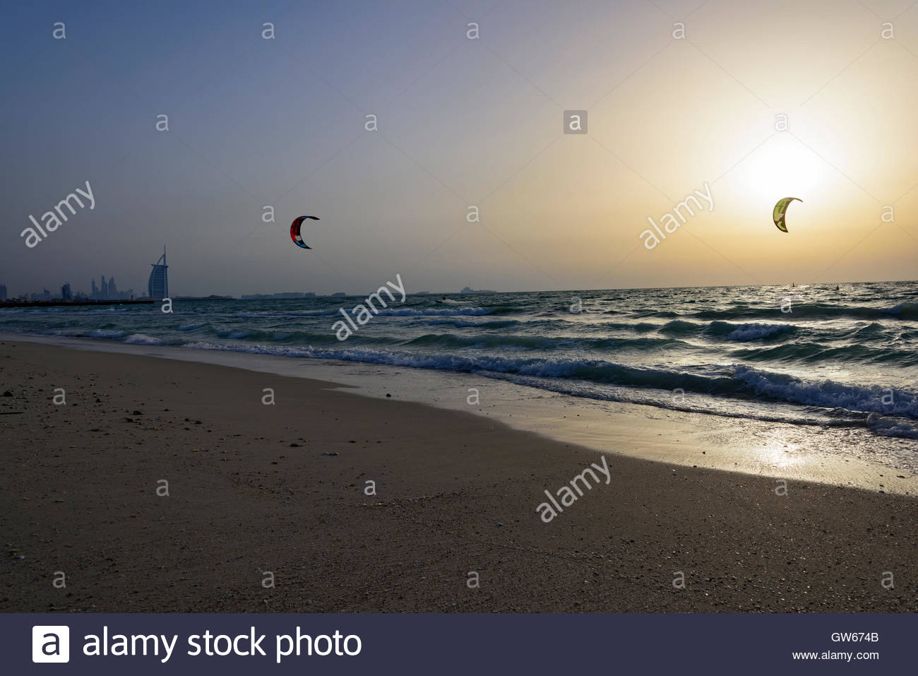 Kite Surf in Dubai with the famous Burj Al Arab hotel in background. Picture taken during a sunset. Dubai Emirates, Stock Photo