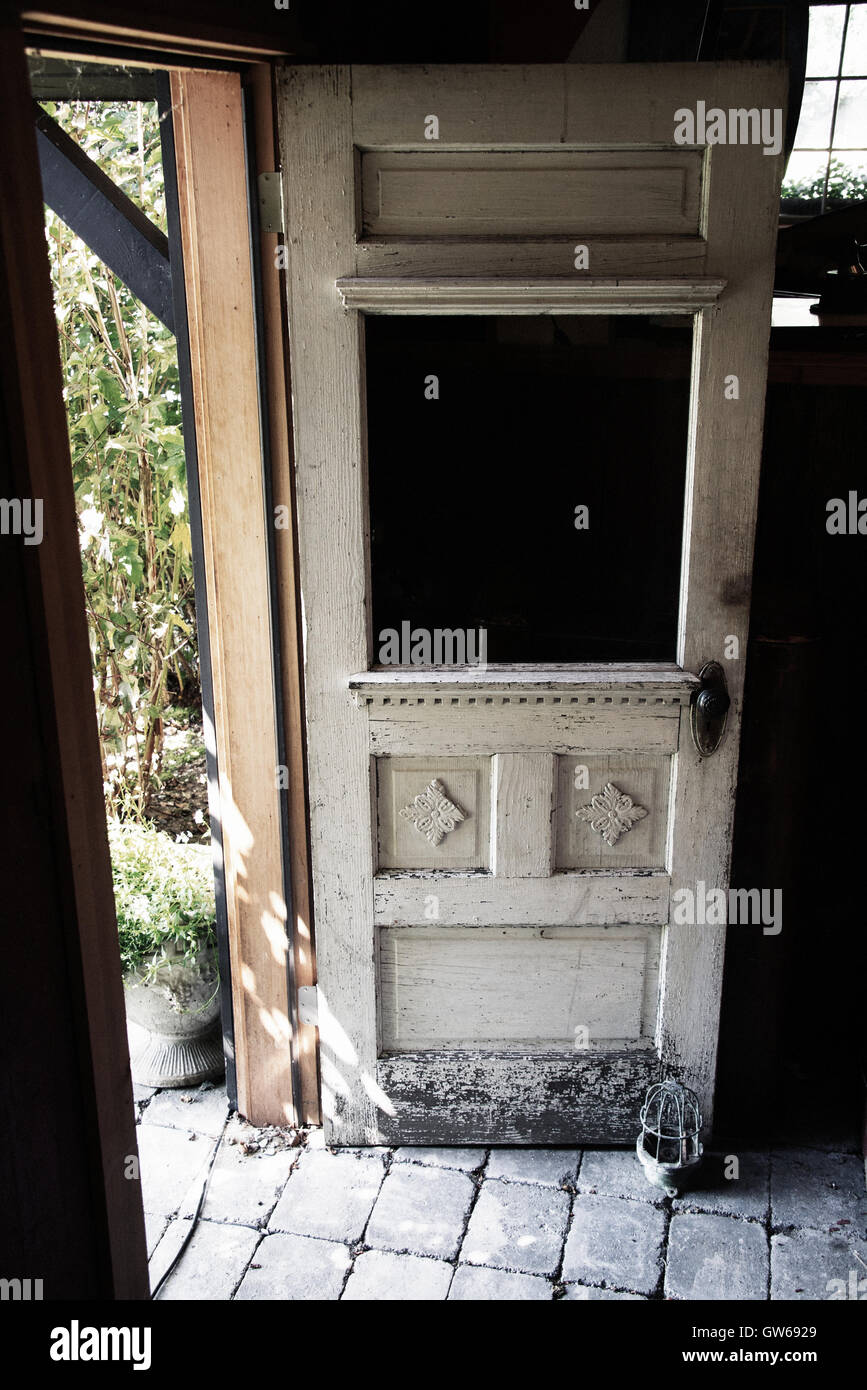 old wood door propped open & old wood door propped open Stock Photo: 118767441 - Alamy