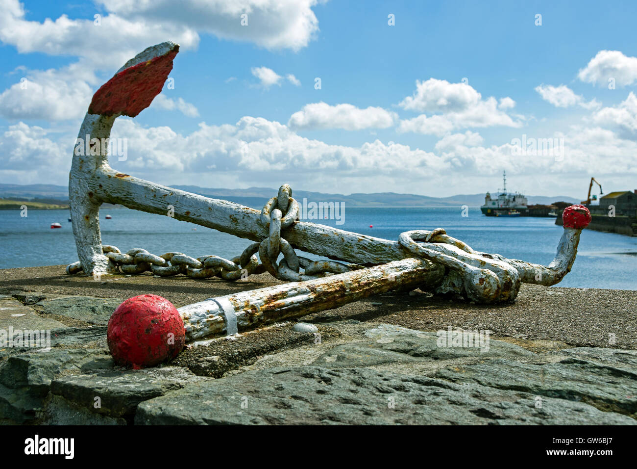Old anchor on the harbour wall at Ardrishaig, Argyll and Bute, Scotland, UK Stock Photo