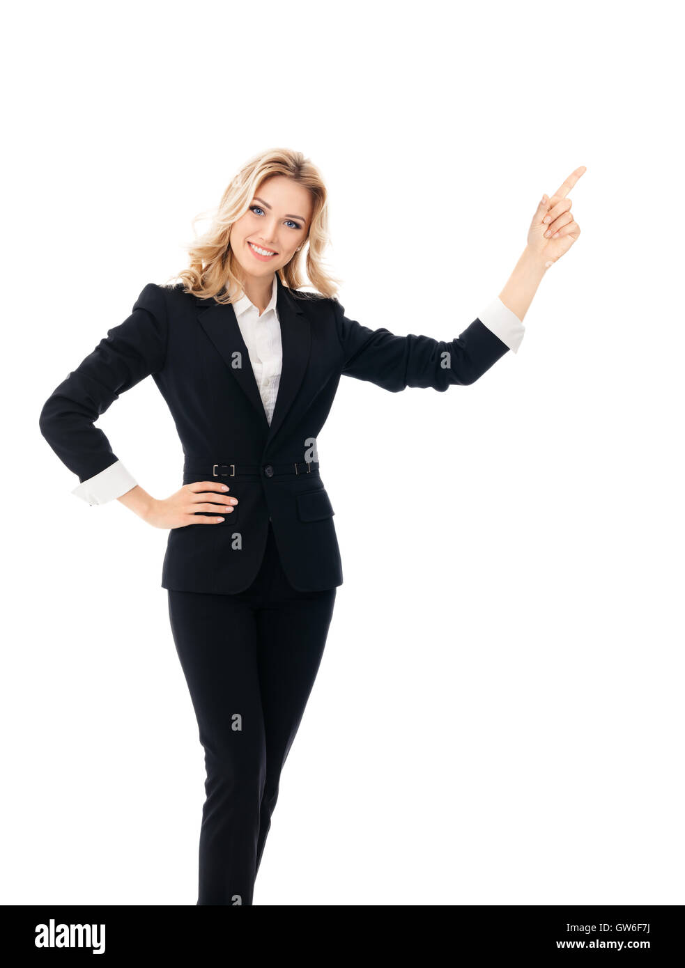 Portrait of happy smiling young cheerful businesswoman, showing something or blank copyspace area for slogan or - Stock Image