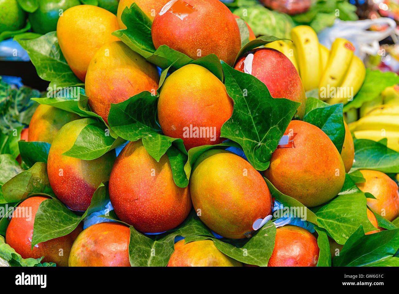 Mango fruits at Boqueria market in Barcelona. - Stock Image