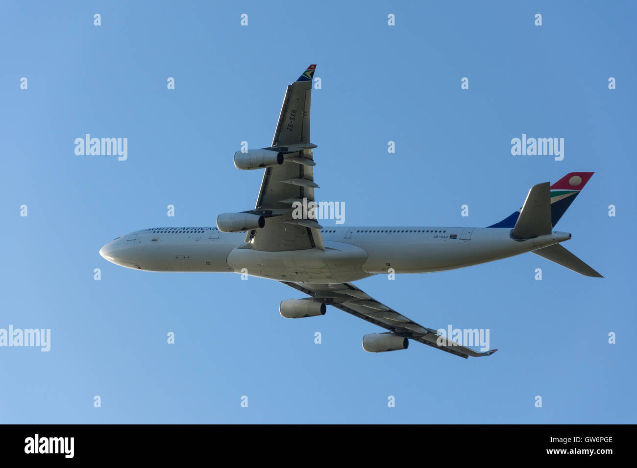 South African Airways Airbus A340-313 aircraft taking off from Heathrow Airport, Greater London, England, United Stock Photo