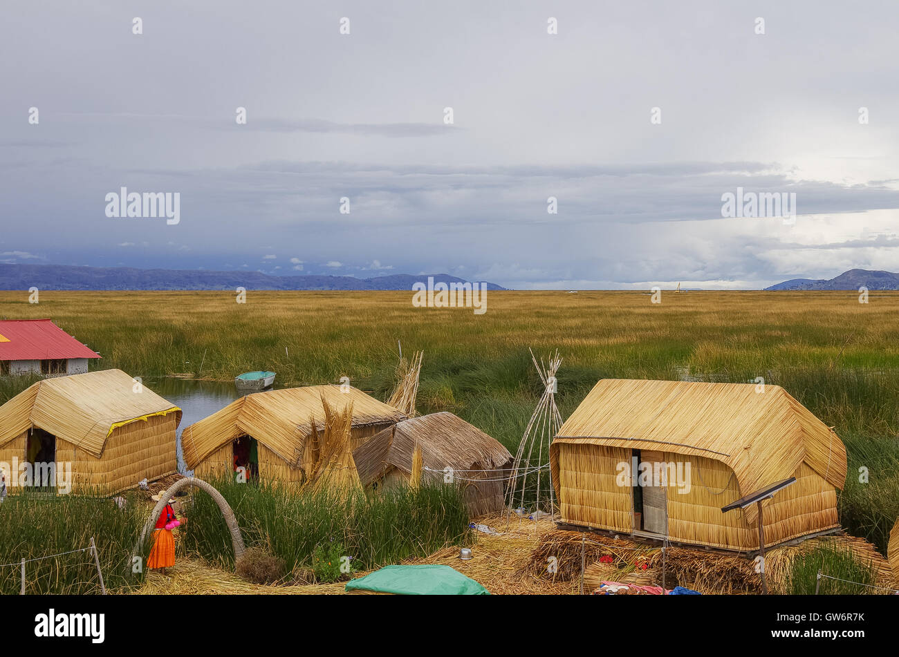 Titicaca, Peru, January 4, 2015 -  Traditional houses of local people in Uros islands on Lake Titicaca. - Stock Image