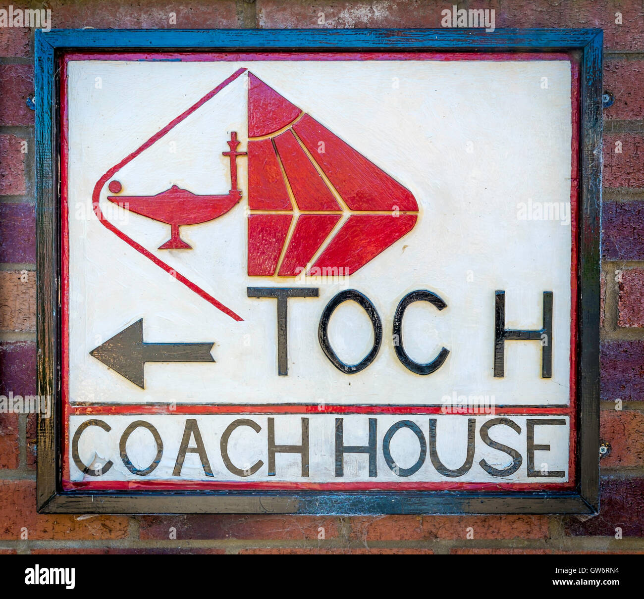 A direction sign TOC H  Coach House - Stock Image