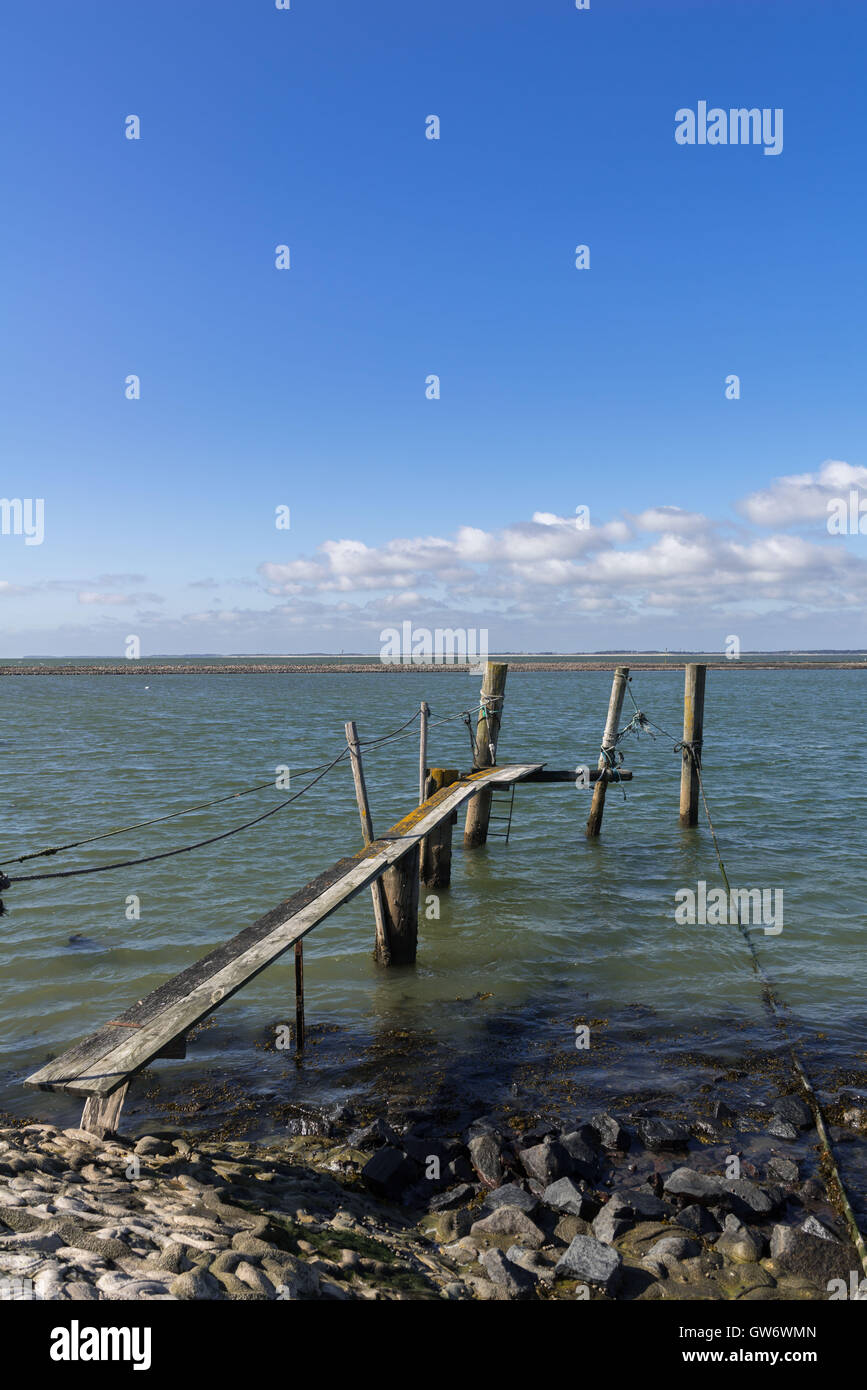 A very old out of function landing stage on the islet of Langeness in the mud flats, North Sea, Schleswig-Holstein, - Stock Image