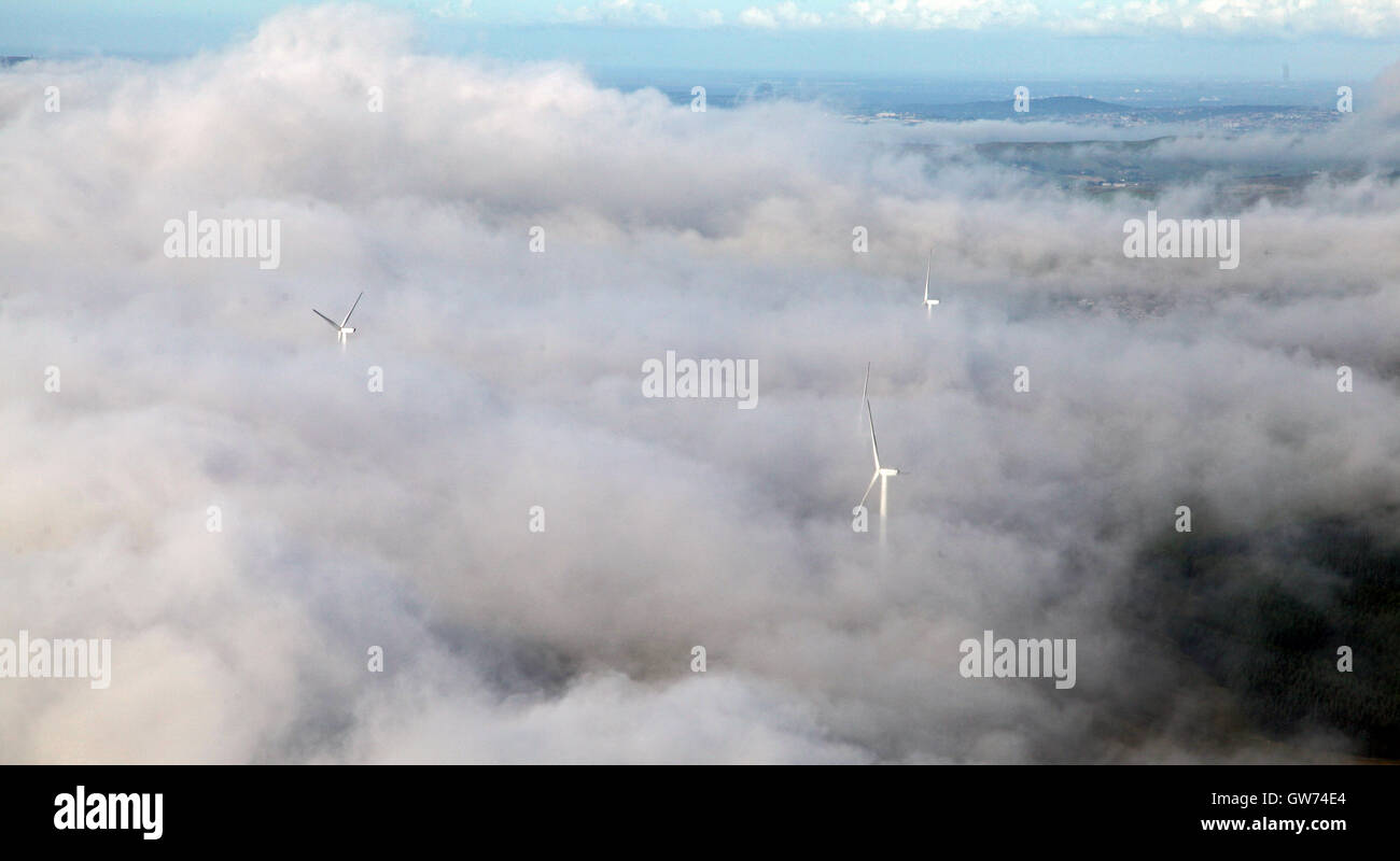 aerial view of wind turbines in cloud - Stock Image
