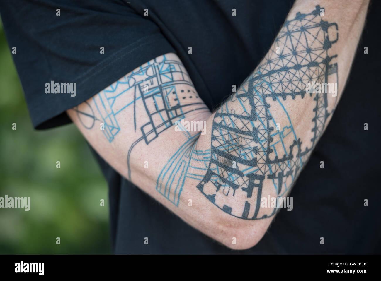 Architect Joachim Traeuptmann Presents His Underarm Tattoo