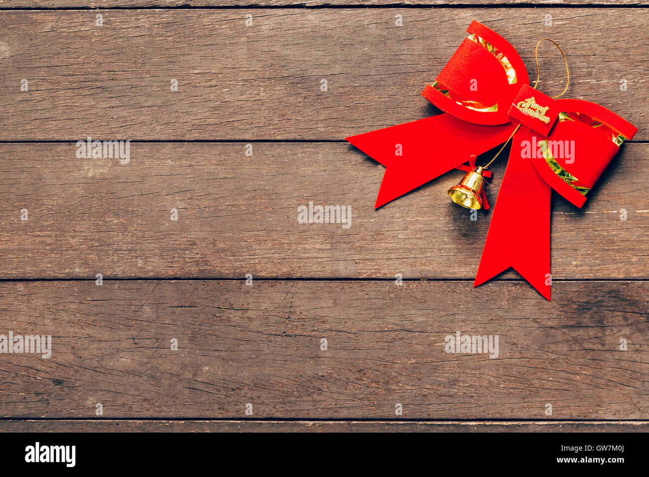 Red bow christmas on wood background with copyspace. - Stock Image