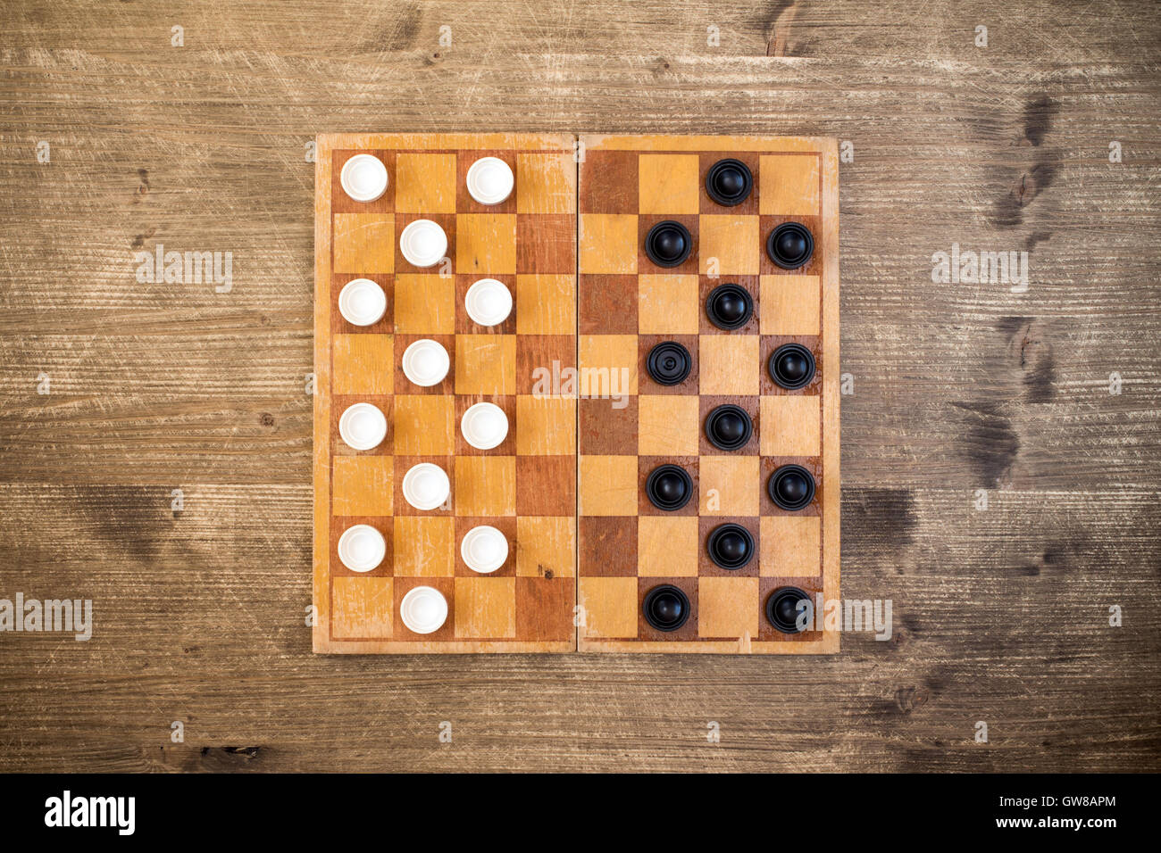 Top view of draughts checkers board game - Stock Image