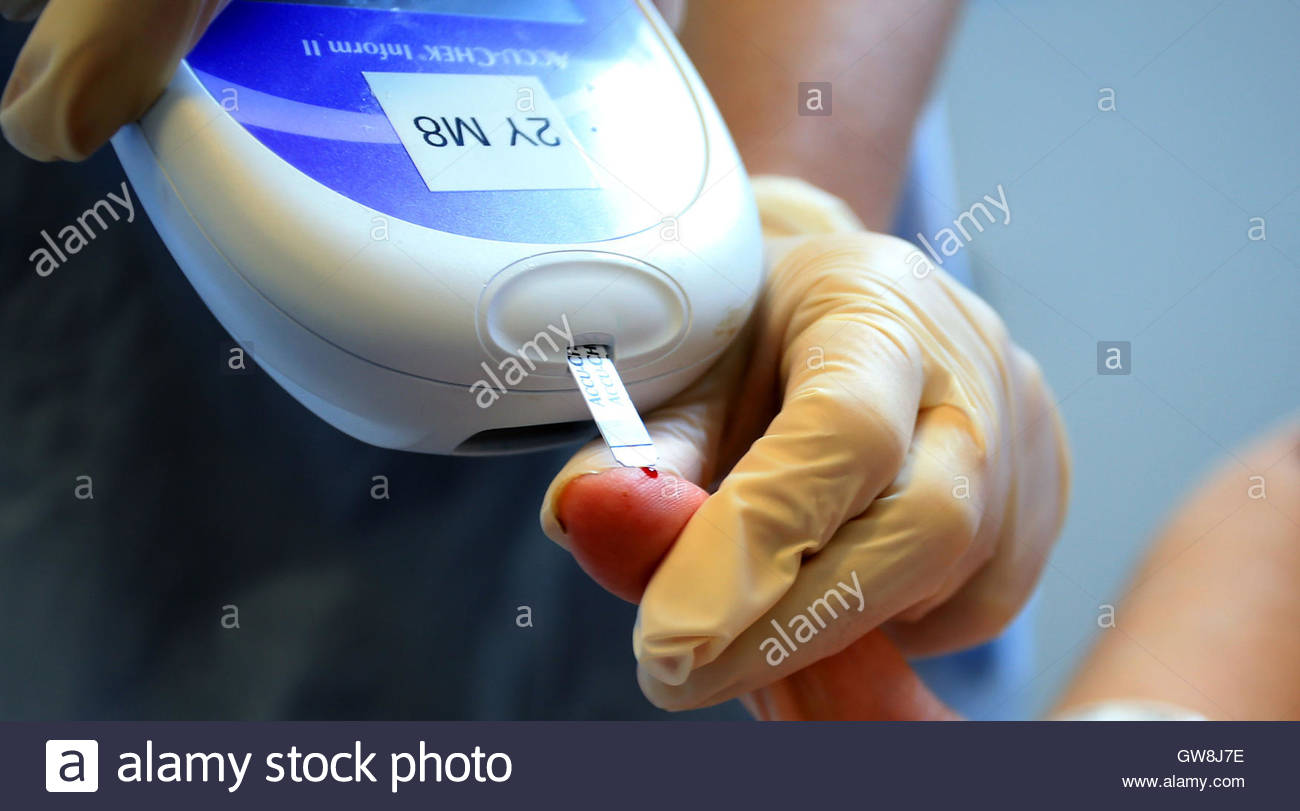 Embargoed to 0001 Tuesday September 13 File photo dated 03/10/14 of a nurse giving a patient a diabetes test, as - Stock Image