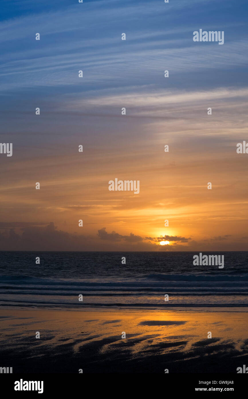 An intense sunset at Fistral Beach in Newquay, Cornwall. - Stock Image