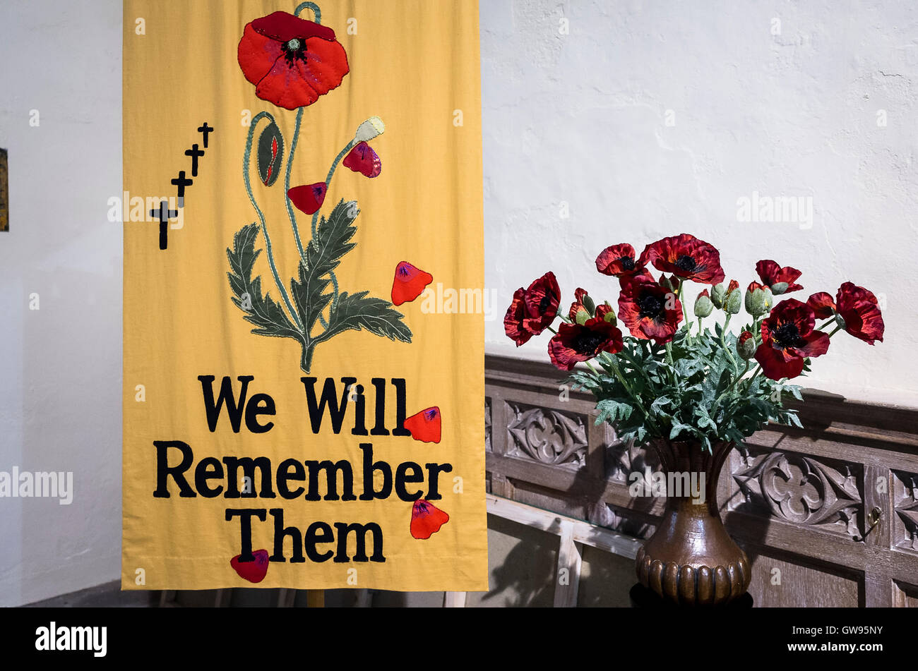 We Will Remember Them banner in a Welsh church UK - Stock Image