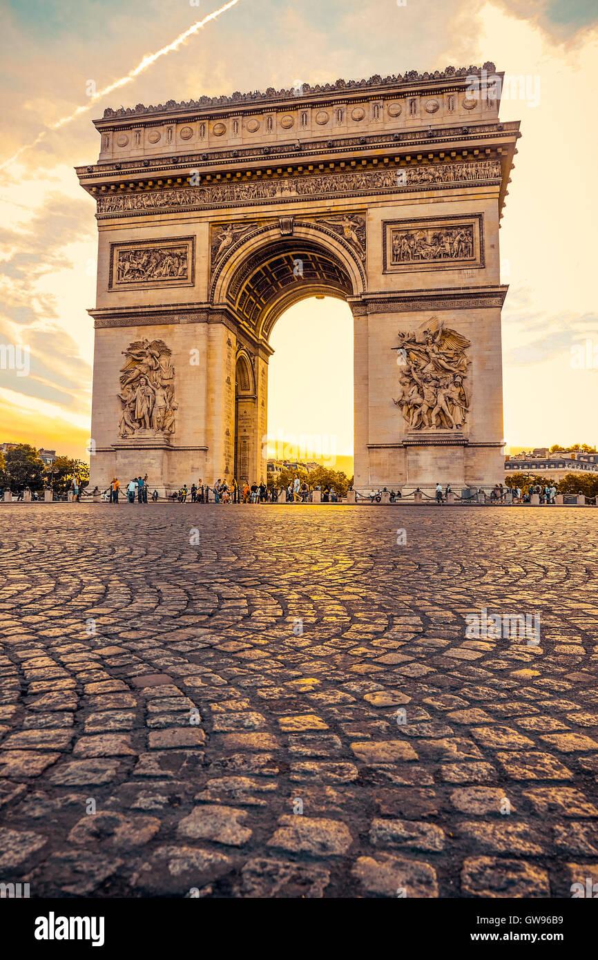 Beautiful sunset over Arc de Triomphe at Place de l'Etoile, Paris, France - Stock Image