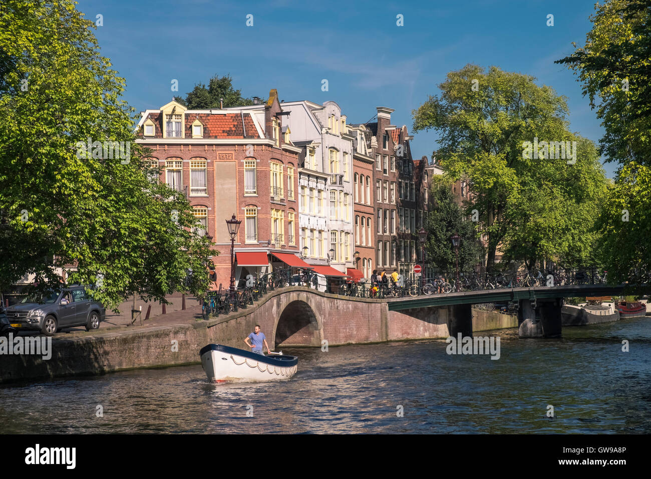 Small boat on Prinsengracht canal, Amsterdam, Netherlands. - Stock Image