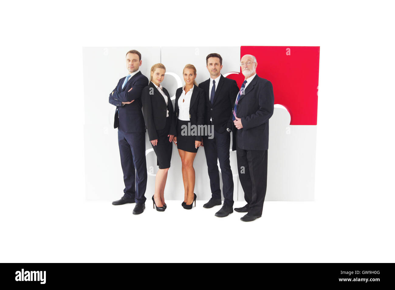 Business people team and assembled puzzle isolated on white background - Stock Image