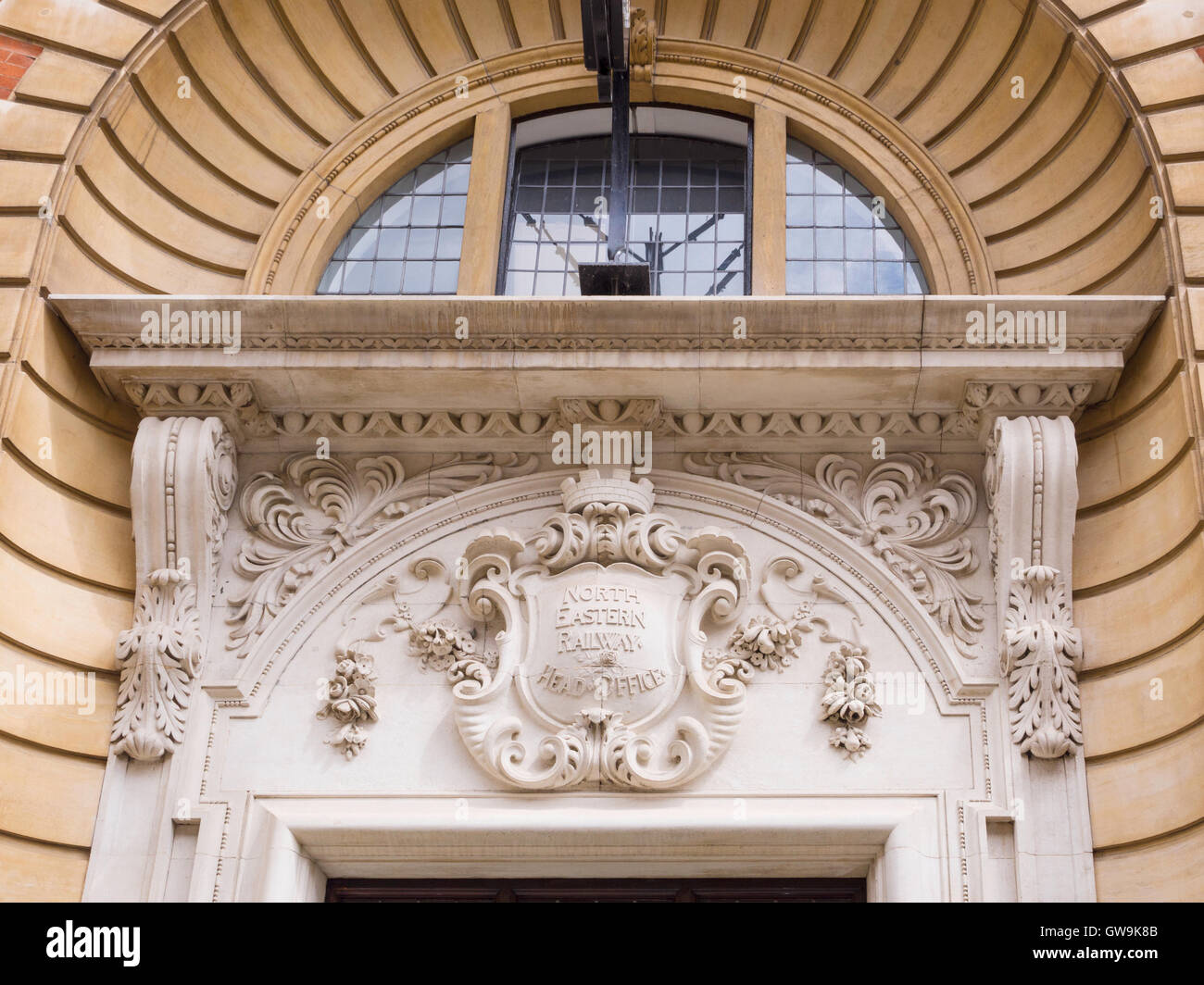 Entrance detail of former headquarters offices (1906) of the North Eastern Railway in York, England, designed by - Stock Image