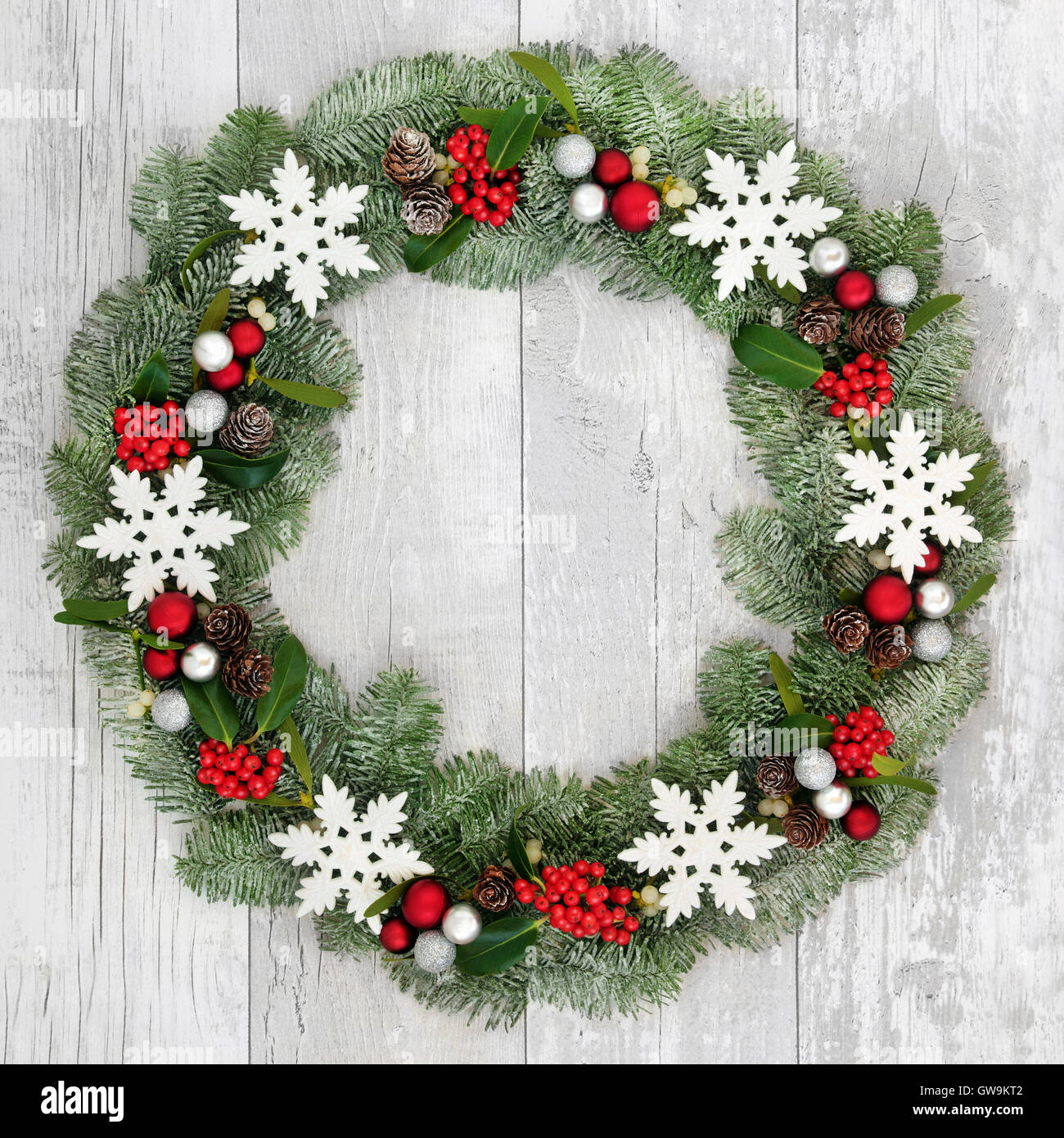 Christmas wreath decoration with white snowflake and silver and red ...