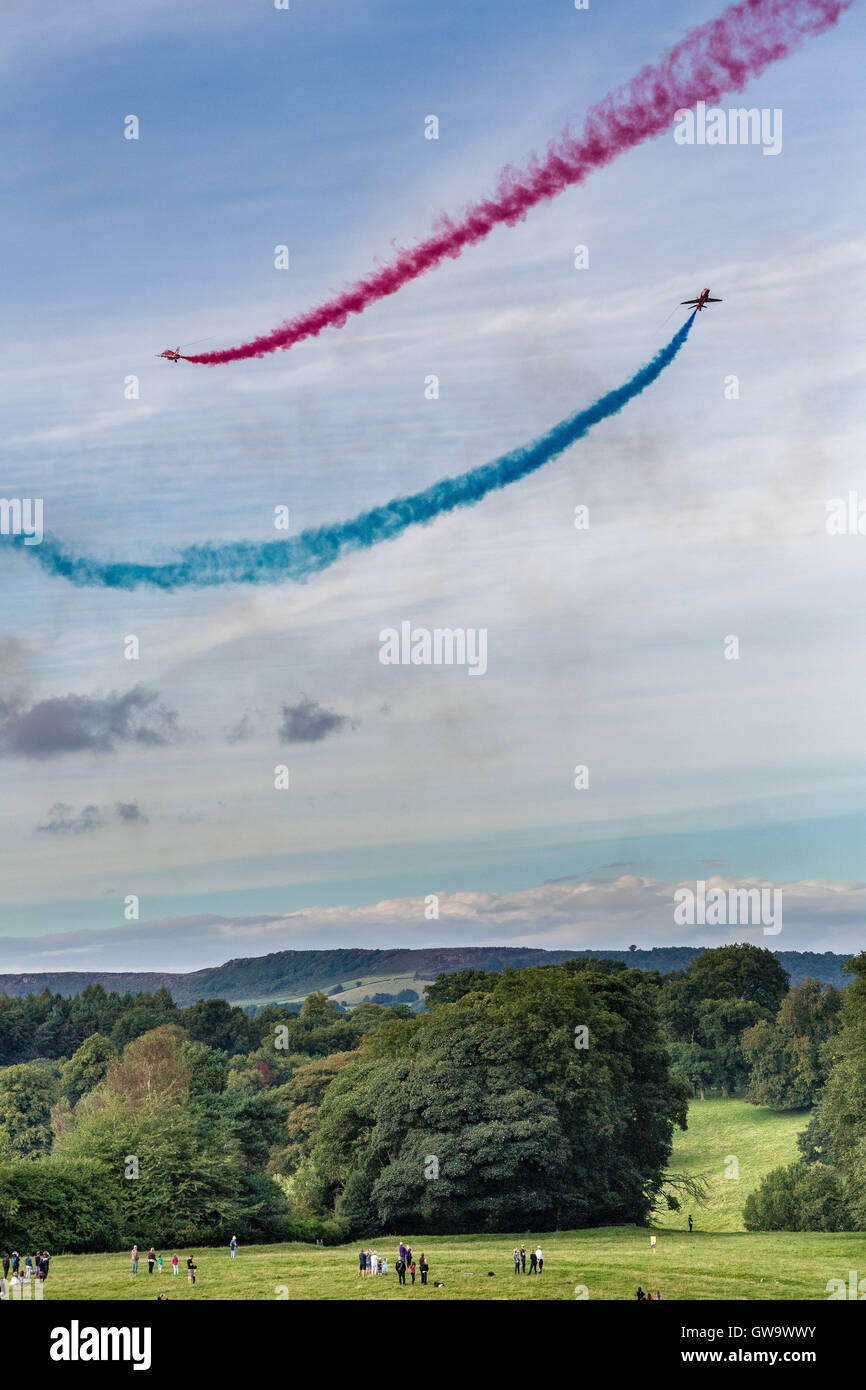 The Red Arrows aerobatics display team (or Royal Air Force Aerobatic Team) performing at Chatsworth Park on 4th - Stock Image