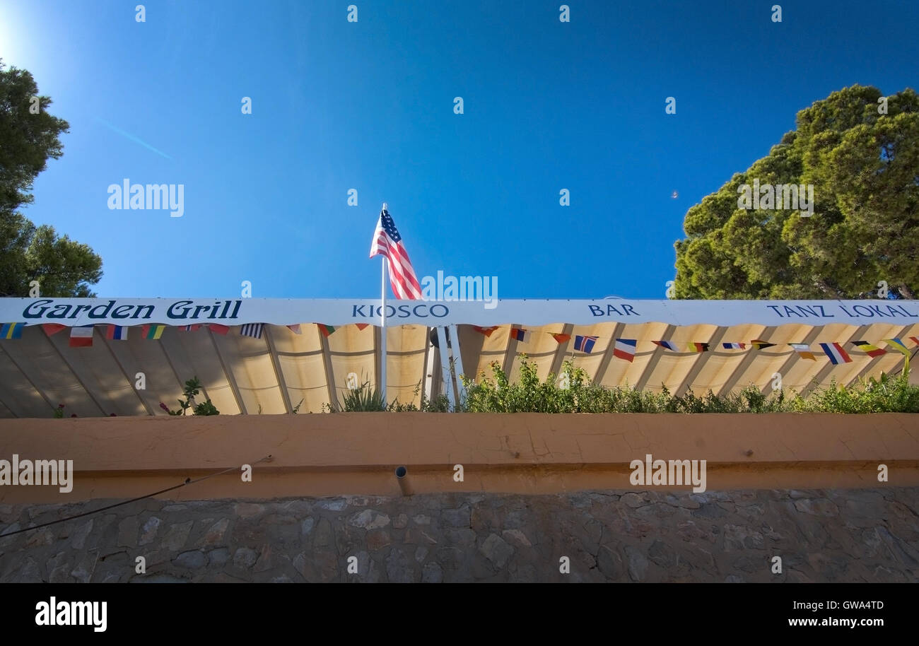 Garden grill and bar with American flag on a sunny day on September 6, 2016 in Paguera, Mallorca, Spain. - Stock Image