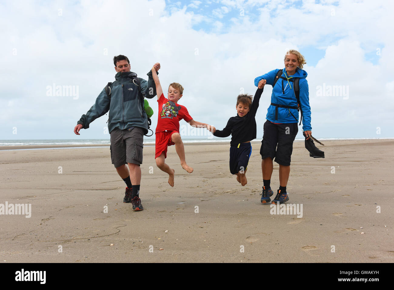 Family on the beach at Tywyn in Mid Wales UK - Stock Image