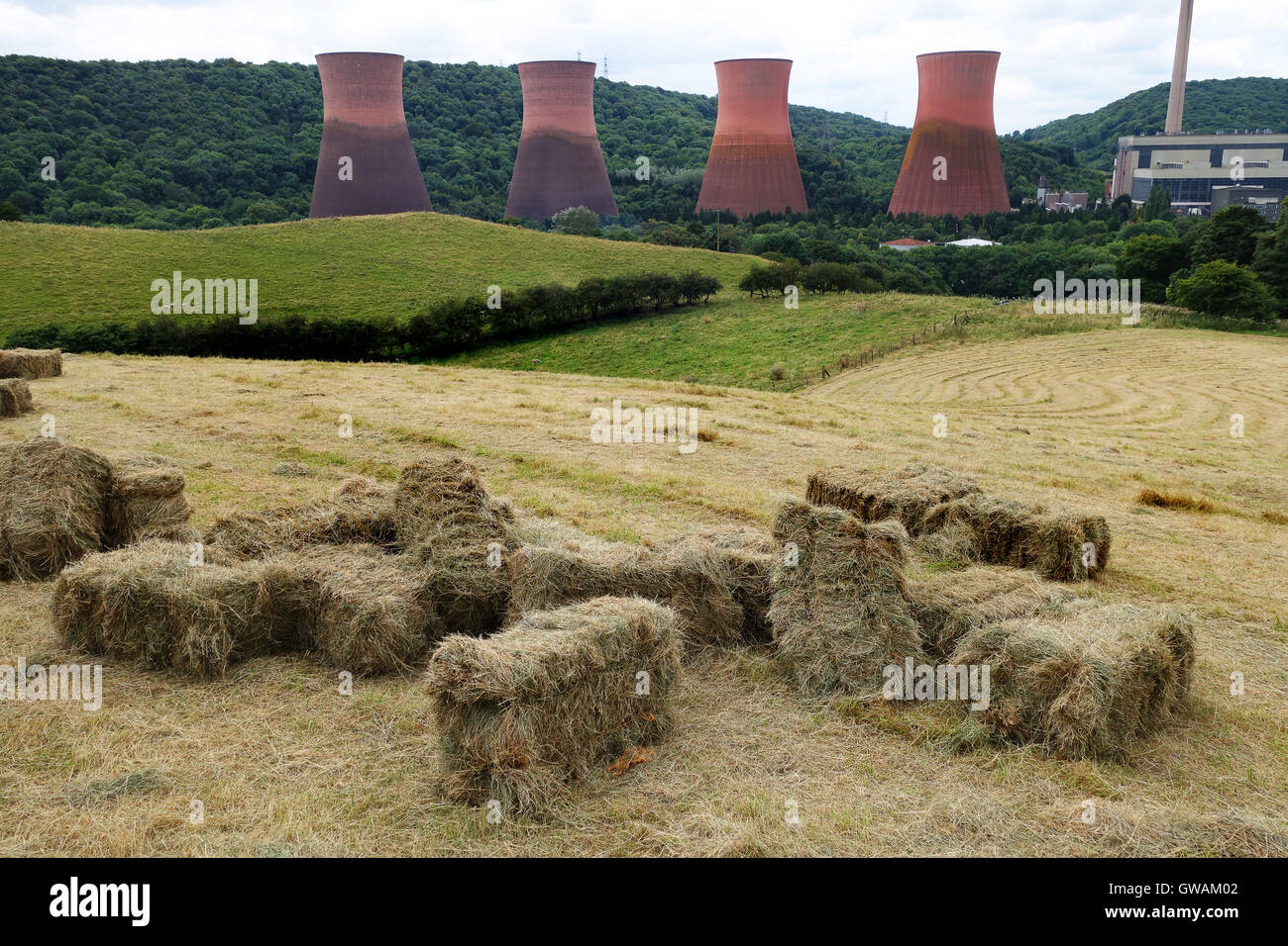 Redundant power station with bales of hay and farmland at Buildwas Ironbridge Shropshire Uk - Stock Image
